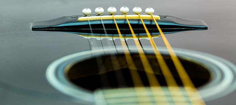 Entretien, réparation et ajustement de guitares acoustiques & classiques sur la rive-sud